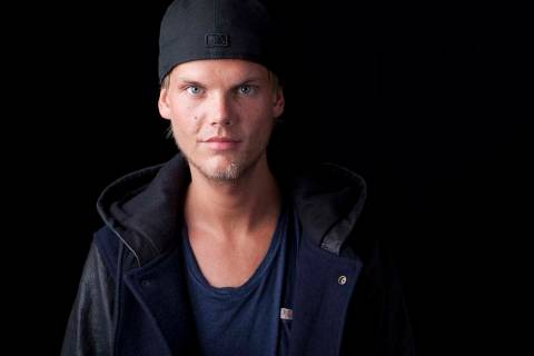 In this Aug. 30, 2013 file photo, Swedish DJ, remixer and record producer Avicii poses for a portrait, in New York. (Amy Sussman/Invision/AP, File)