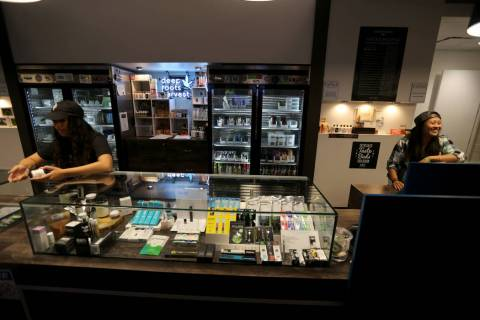 Alyssa Jusino, left, and Jezrey Saenz help customers at Exhale Nevada marijuana dispensary in Las Vegas Thursday, June 28, 2018. K.M. Cannon Las Vegas Review-Journal @KMCannonPhoto