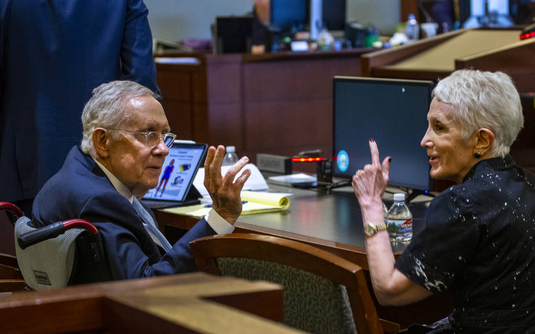 Former U.S. Sen. Harry Reid and wife Landra greet a friend in the gallery during Reid's civil trial against the makers of an exercise band at the Regional Justice Center on Tuesday, March 26, 2019 ...