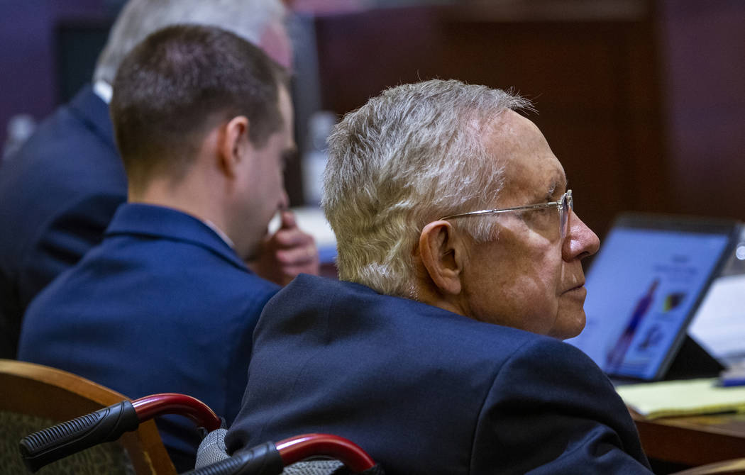 Former U.S. Sen. Harry Reid listens to opening statements during his civil trial against the makers of an exercise band at the Regional Justice Center on Tuesday, March 26, 2019, in Las Vegas. (L. ...