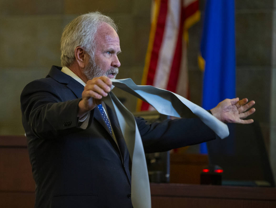 Jim Wilkes, attorney for former U.S. Sen. Harry Reid, displays a flexible exercise band during opening statements in a civil trial at the Regional Justice Center on Tuesday, March 26, 2019, in Las ...