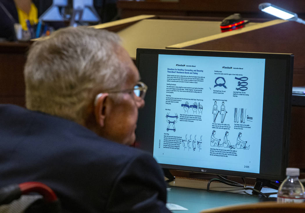 Former U.S. Sen. Harry Reid listens to opening statements during his civil trial against the makers of an exercise band at the Regional Justice Center on Tuesday, March 26, 2019, in Las Vegas. A g ...