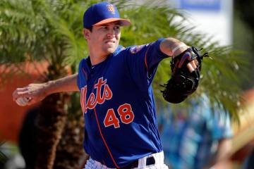 New York Mets pitcher Jacob deGrom throws a bullpen session during spring training baseball practice Thursday, Feb. 14, 2019, in Port St. Lucie, Fla. (AP Photo/Jeff Roberson)