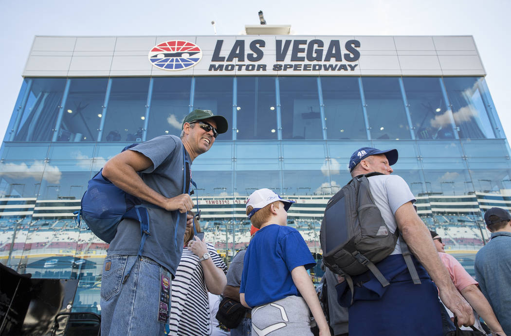 Attendees walk on pit row before the start of the Monster Energy NASCAR Cup Series Pennzoil 400 on Sunday, March 3, 2019, at Las Vegas Motor Speedway, in Las Vegas. (Benjamin Hager Review-Journal) ...