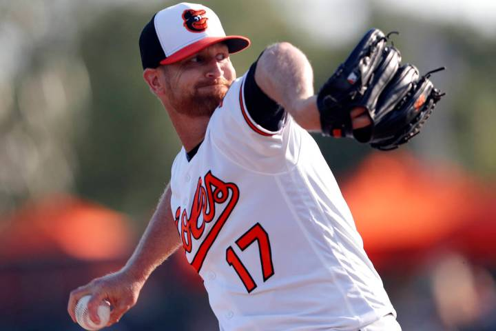 Baltimore Orioles starting pitcher Alex Cobb (17) works Minnesota Twins in the first inning of a spring training baseball game Saturday, March 23, 2019, in Sarasota, Fla. (AP Photo/John Bazemore)