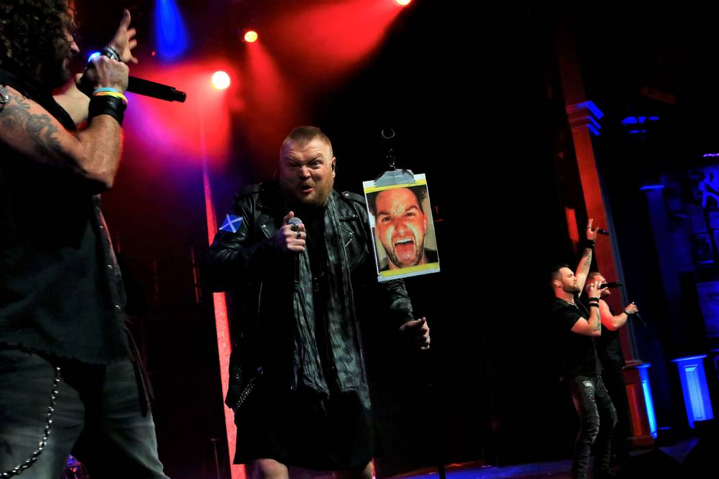 Jimmy Denning of Tenors of Rock shows a photo of bandmate Tommy Sherlock during the act's final show at Harrah's Showroom on Monday, March 25, 2019. (Ira Kuzma)