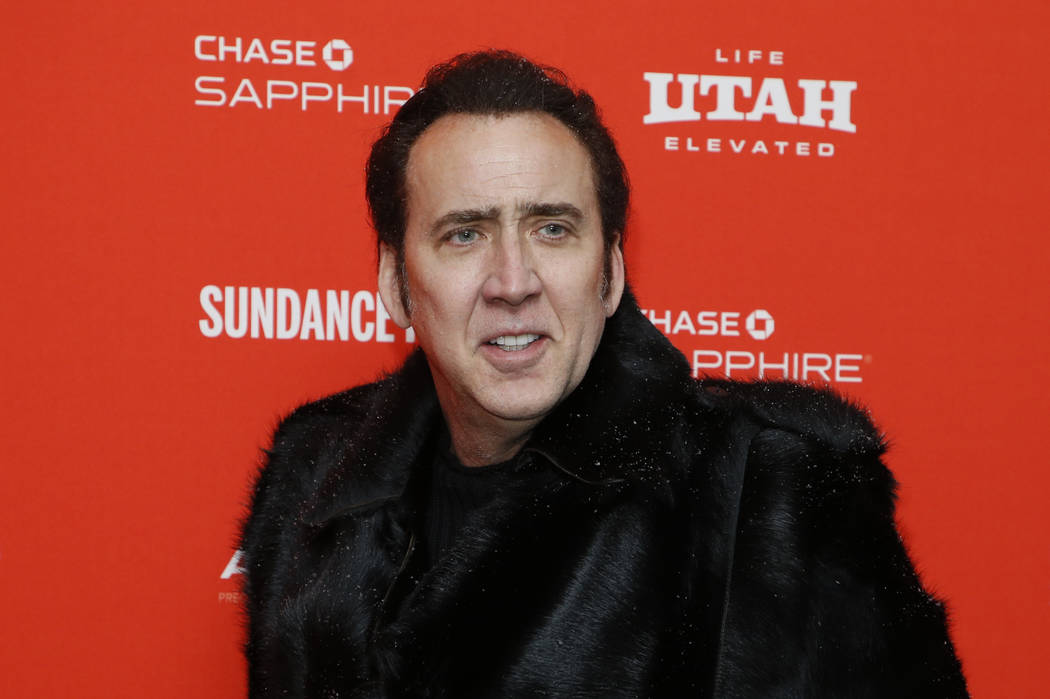 "Actor Nicolas Cage poses Jan. 19, 2018, at the premiere of ""Mandy"" during the 2018 Sundance Film Festival in Park City, Utah. (Photo by Danny Moloshok/Invision/AP, File)"