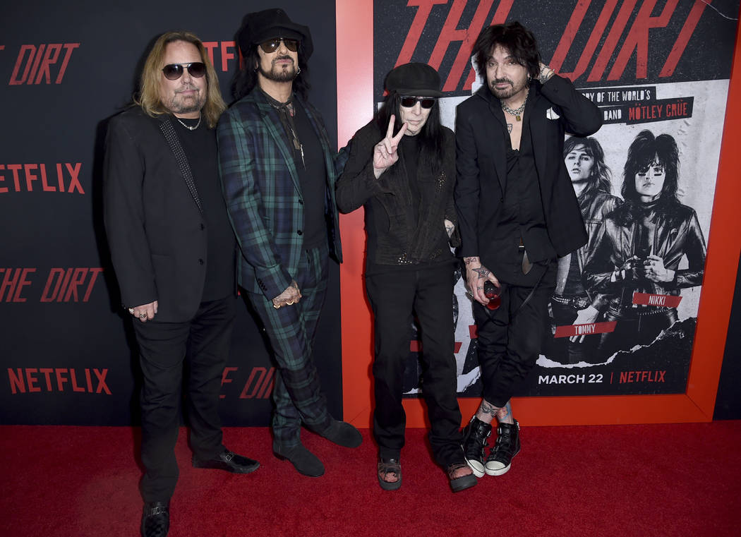"""Vince Neil, from left, Nikki Sixx, Mick Mars and Tommy Lee, of Motley Crue, arrive at the world premiere of """"The Dirt"""" on Monday, March 18, 2019, at ArcLight Hollywood in Los Angeles. (P ..."""