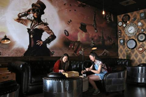 Stephanie Lo, left, and her sister Emily play games at Escapology, where players are locked inside a themed room to play a high adrenaline escape game, before their game on Tuesday, March. 26, 201 ...