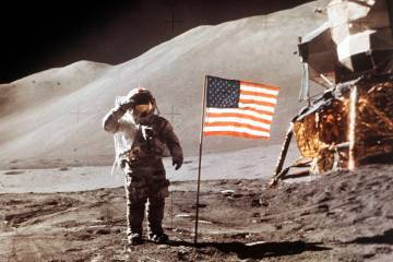 FILE - In this July 30, 1971 photo made available by NASA, Apollo 15 Lunar Module Pilot James B. Irwin salutes while standing beside the fourth American flag planted on the surface of the moon. On ...