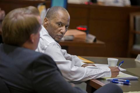 Defendant Leonard Woods, right, consults with his counsel during closing arguments on Monday, March 25, 2019, at the Regional Justice Center, in Las Vegas. Woods is charged with the fatal stabbing ...