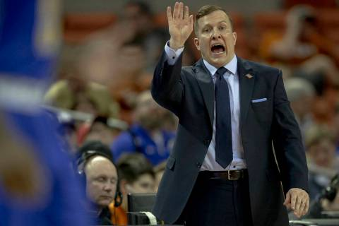 South Dakota State head coach T.J. Otzelberger yells to his team during a first round game against Texas in the NCAA college basketball National Invitation Tournament in Austin, Texas, Tuesday, Ma ...