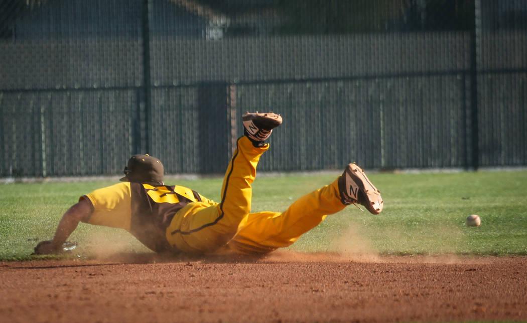 Bonanza shortstop Yankiel Gonzalez (24) misses a ground ball during a baseball game against Cimarron-Memorial High School at Bonanza High School in Las Vegas, Tuesday, March 26, 2019. (Caroline Br ...