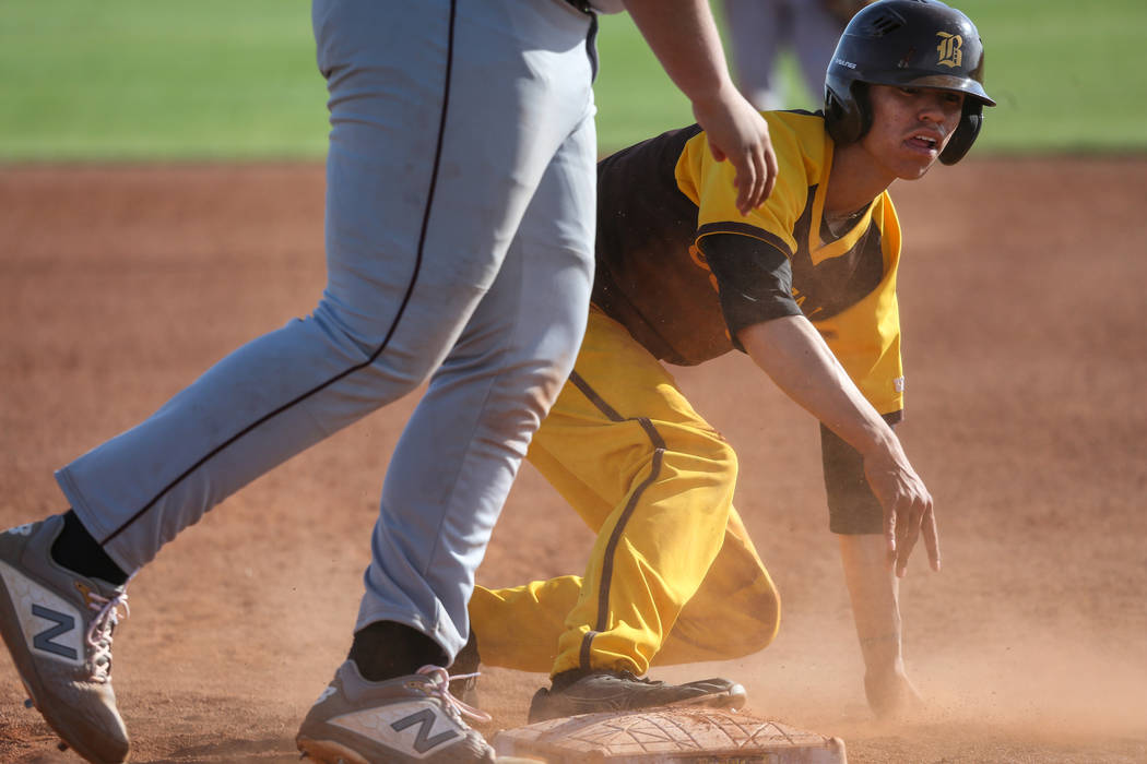 Bonanza second baseman Julian DeLeon (3) slides safely into first base during a baseball game against Cimarron-Memorial High School at Bonanza High School in Las Vegas, Tuesday, March 26, 2019. (C ...