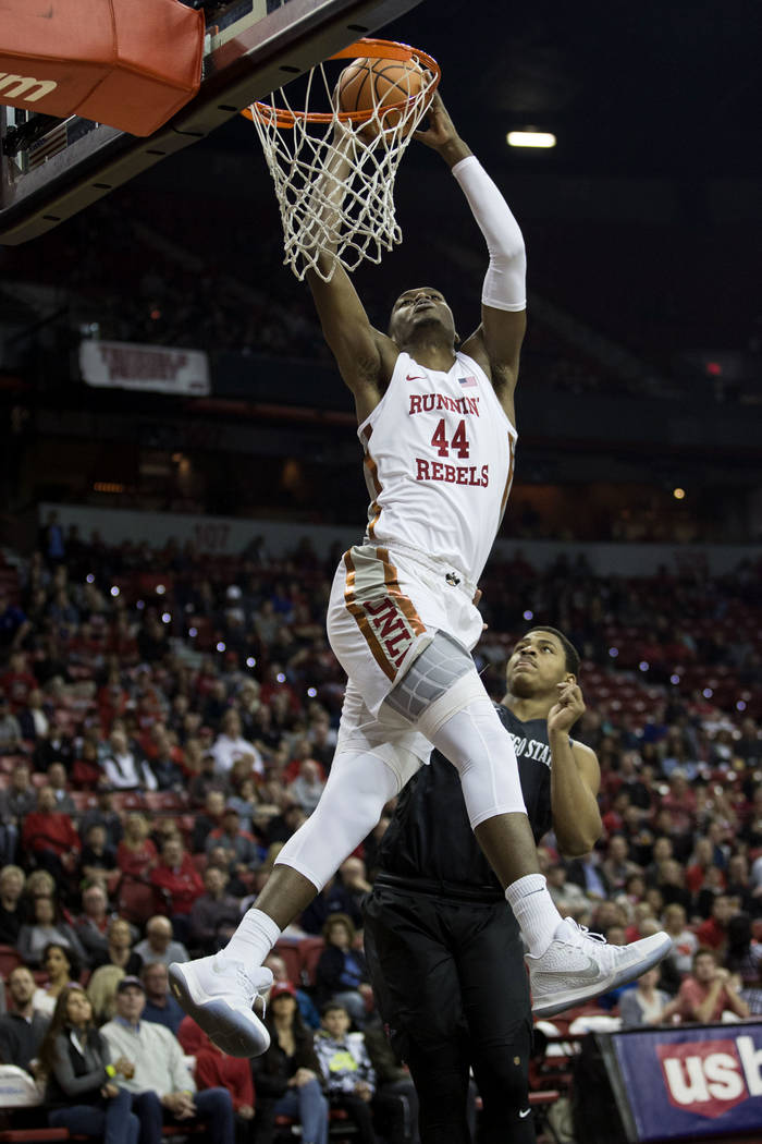 UNLV Rebels forward Brandon McCoy (44) dunks the ball against San Diego State Aztecs at the Thomas & Mack Center in Las Vegas, Saturday, Jan. 27, 2018, as San Diego State Aztecs forward Matt M ...