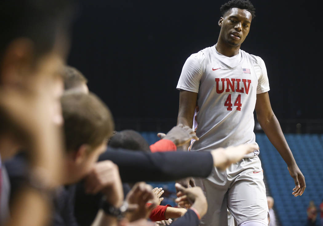 UNLV's Brandon McCoy (44) gets high-fives on his way back to the bench during his team's basketball game against Oral Roberts at the MGM Grand Garden Arena in Las Vegas on Tuesday, Dec. 5, 2017. U ...