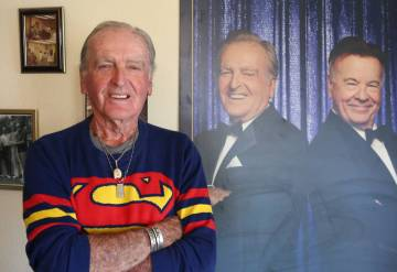 John Barbour, an actor, comedian, television host, poses for a photo next to Knuckles and Nash' ...