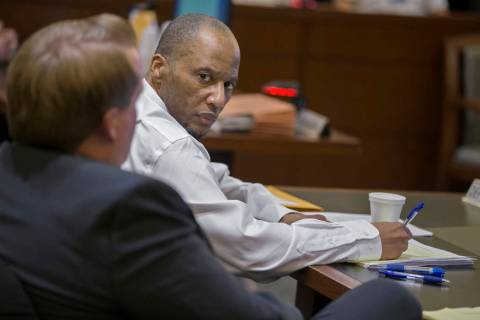 Defendant Leonard Woods, right, consults with his counsel during closing arguments on Monday, M ...