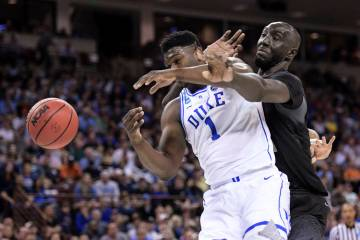 Central Florida center Tacko Fall (24) defends against Duke forward Zion Williamson (1) during the first half of a second-round game in the NCAA men's college basketball tournament Sunday, March 2 ...