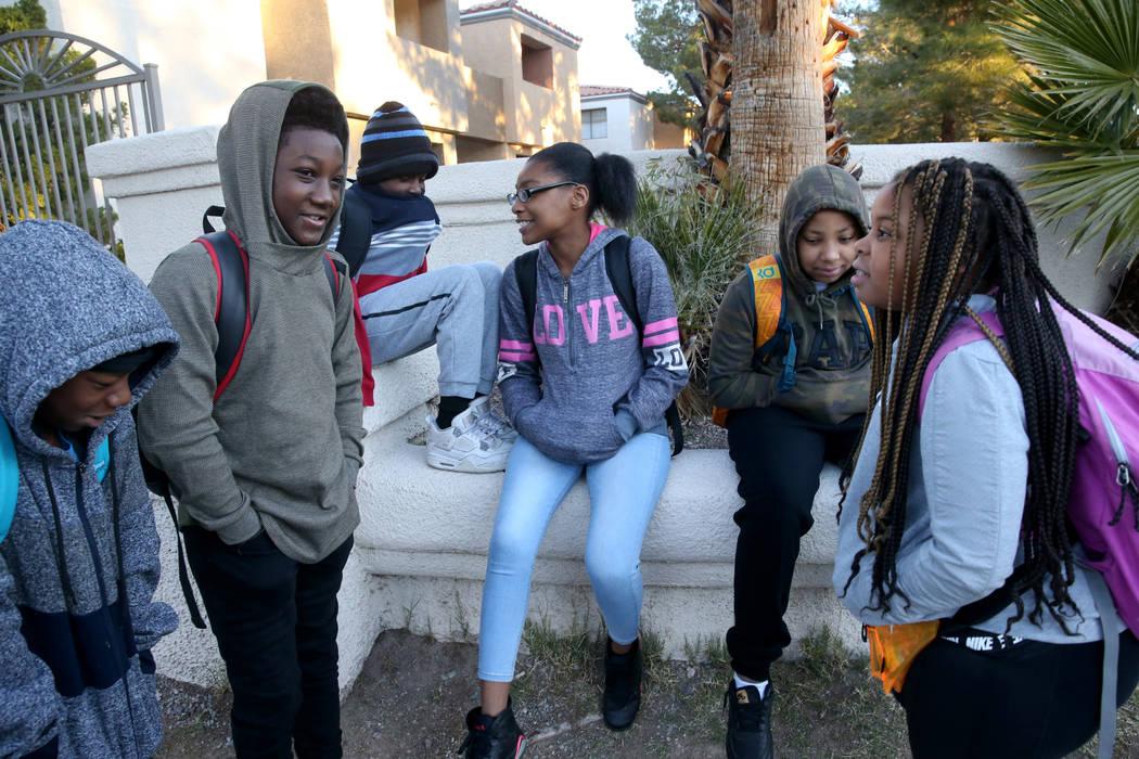 Students, from left, Taejon Brown, 11, Nicholas Jackson, 12, Detrik Gordon, 14, Ariana Patterso ...