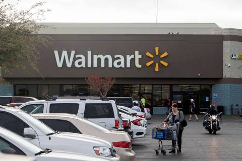 Shoppers exit Walmart at Cheyenne Commons strip mall on Thursday, Dec. 20, 2018, in Las Vegas. ...