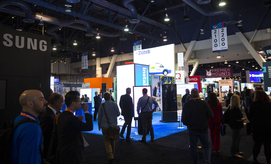 Attendees explore the show floor at the Digital Signage Expo at the Las Vegas Convention Center ...