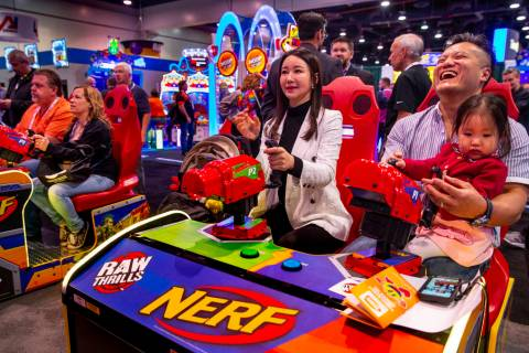Hwa Yeon Lee with husband James and daughter Vivian, 2, with FunXcess enjoy a turn on the Nerf ...
