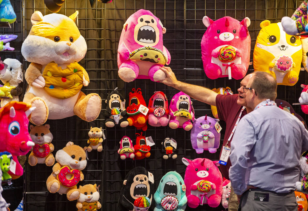 Bob Souza with Peek-A-Boo Toys shows off his stuffed animals during the the Amusement Expo at t ...