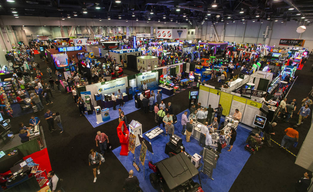 The showroom floor is packed with games and other merchandise to test out during the the Amusem ...
