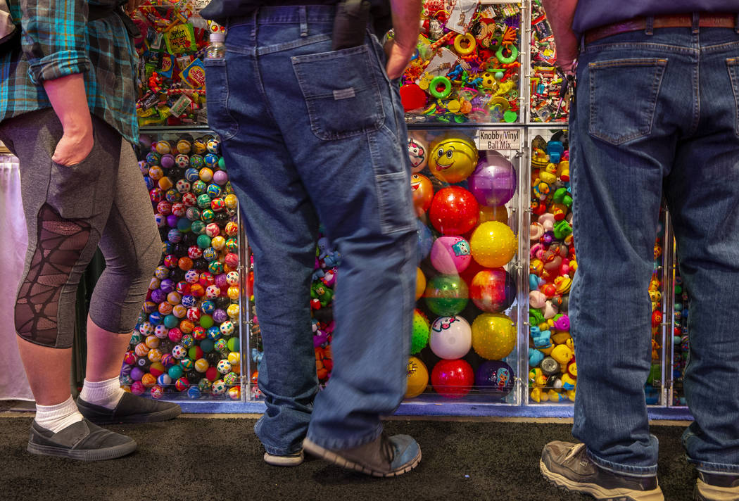 Attendees view some of the many game prizes for sale during the the Amusement Expo at the Las V ...