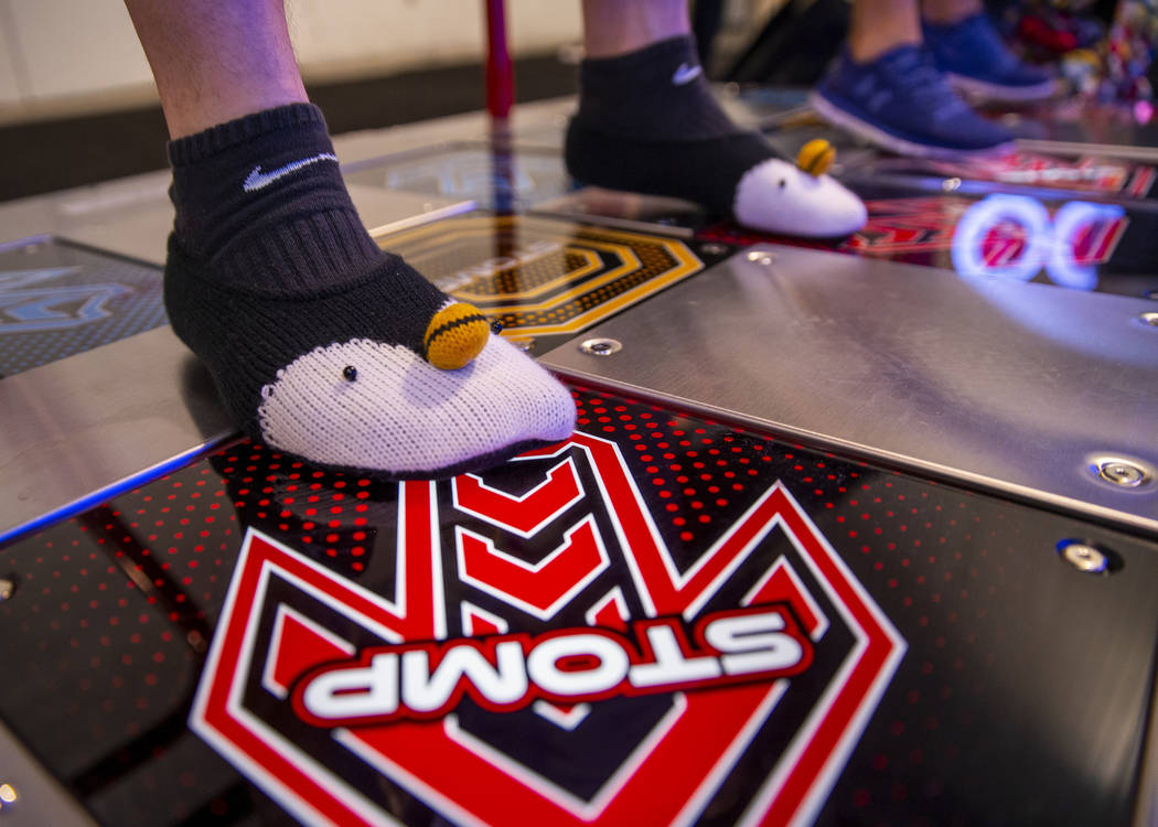 Michael Alvarado with XERO steps forward wearing penguin socks while paying Pump It Up during t ...