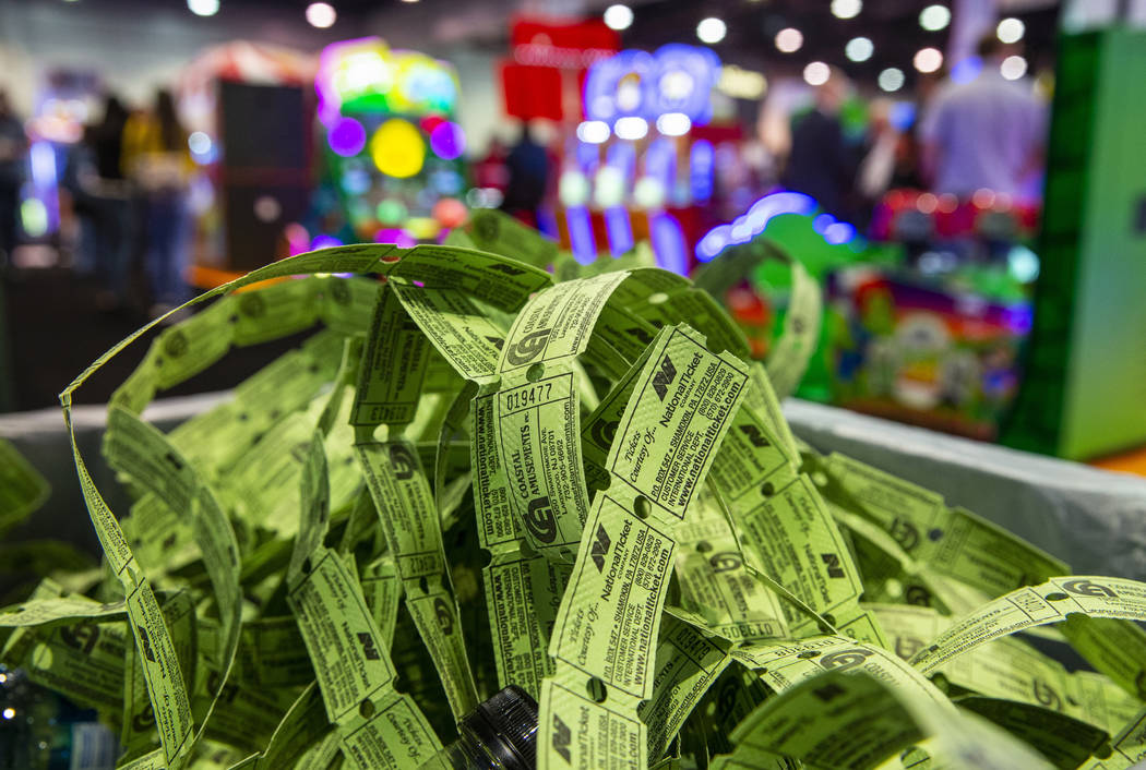 A pile of spent game tickets fills a trash can during the the Amusement Expo at the Las Vegas C ...
