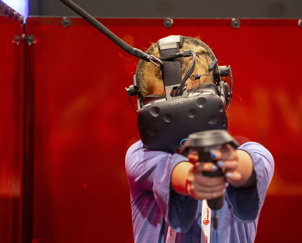 Adelle Evans of Reno, Nevada, tries out a VR Maze game by Triotech during the the Amusement Exp ...