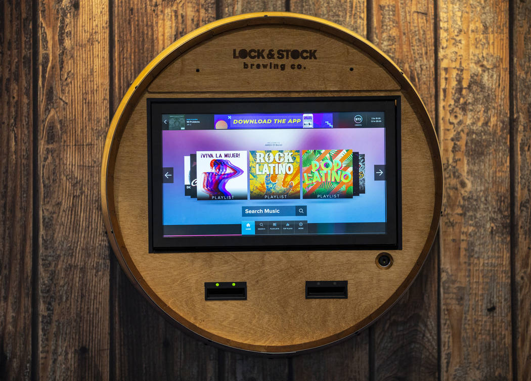 The Fusion Barrel Edition music player by TouchTunes on display during the the Amusement Expo a ...