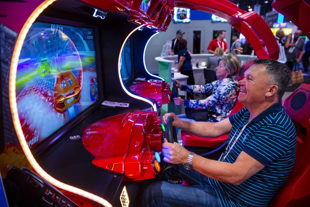 Lazlo Baranyai with Lorincz & Baranyai LTD races a car during the the Amusement Expo at the ...