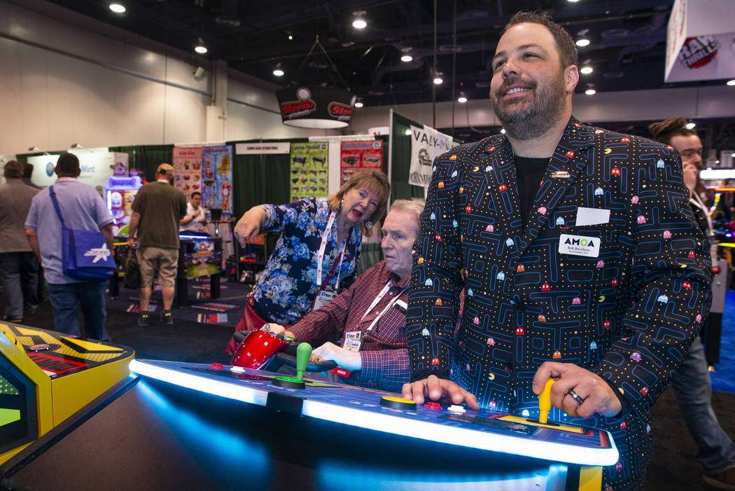 Bob Burnham with Paradise Pinball and Amusement LLC wears his Pacman suit while playing a giant ...