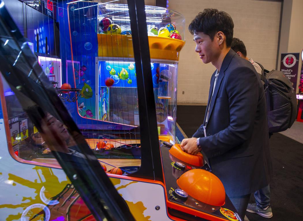 Sung Min Youn with Coastal Amusements Inc., plays a mini basketball game during the the Amuseme ...