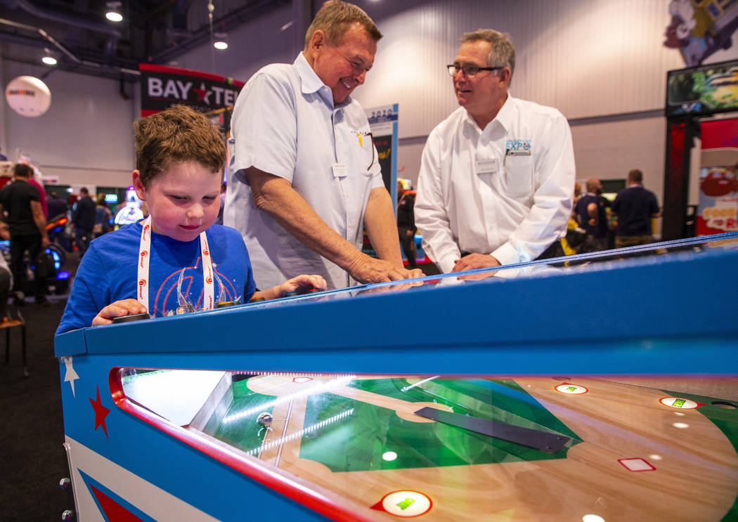 Aiden Fortier with Gamepath Arcade plays a baseball game during the the Amusement Expo at the L ...