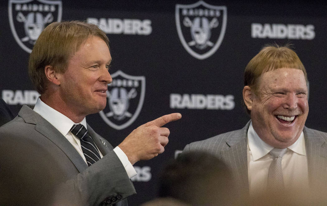 Jon Gruden, left, is announced as the head coach of the Oakland Raiders with owner Mark Davis a ...
