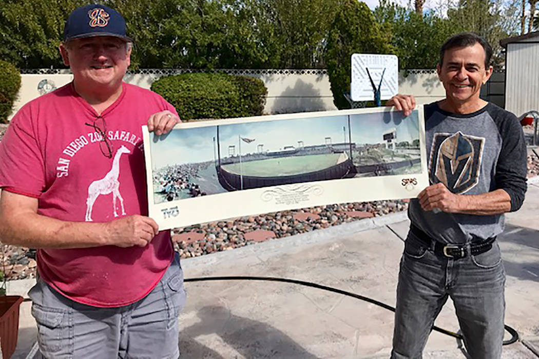 Rene LaComb, left, and Craig Lake hold a commemorative print given to fans at first baseball ga ...