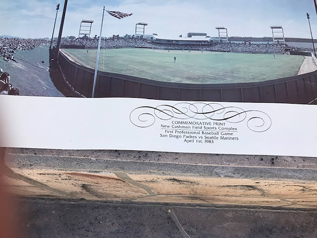 The commemorative print given to fans at the first baseball game in Cashman Field is seen up cl ...