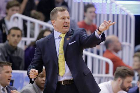 South Dakota State head coach T.J. Otzelberger shouts to his team during the first half of a fi ...