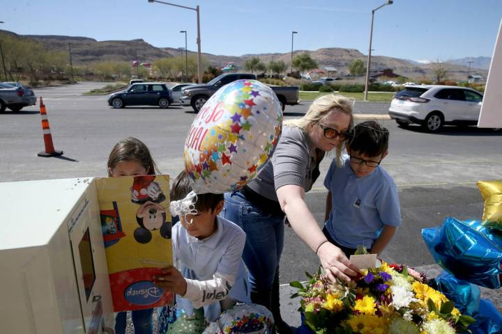 Dawn Yoshimori and three of her five children, from left, Evelyn, 7, Leo, 9, and Talan, 11, vis ...