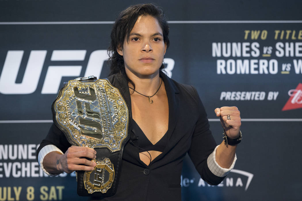In this July 6, 2017, file photo, Amanda Nunes poses during media day for UFC 213 in Las Vegas. ...