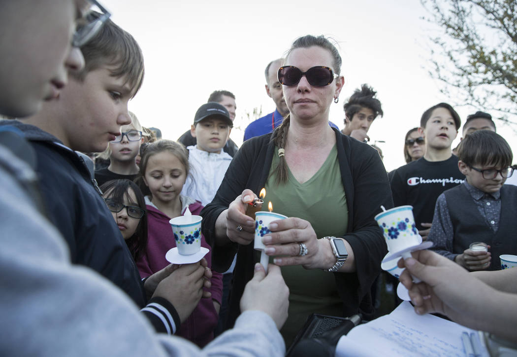 Friends and family light candles during a vigil for Jonathan Smith, 12, who was struck and kil ...