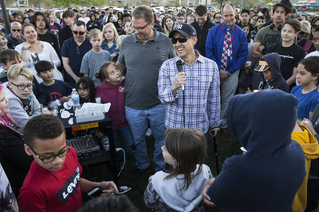 Family friend Mike Mahayosnand, right, shares a light-hearted story about Jonathan Smith, 12, w ...