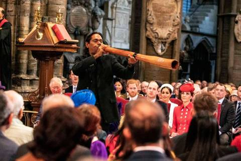 International didgeridoo player William Barton performs during the Commonwealth Service at West ...