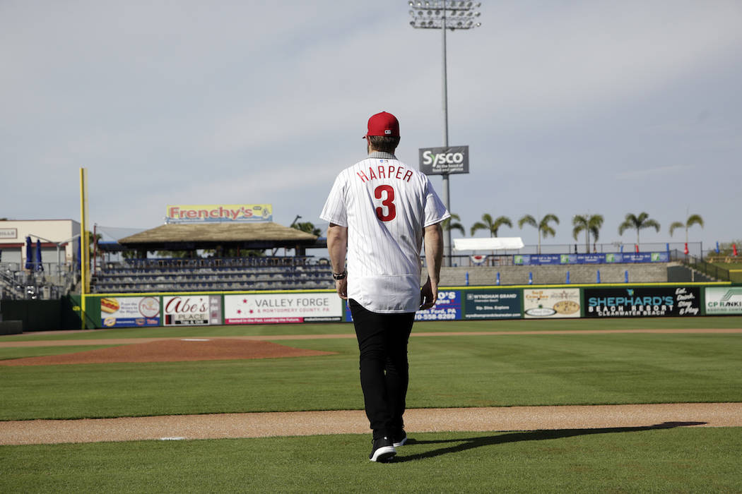 Bryce Harper walks on the field after being introduced as a Philadelphia Phillies player during ...