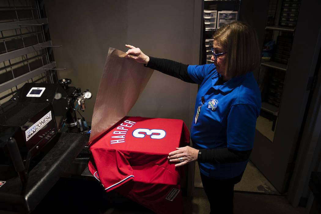 Peggy McBreen makes a Philadelphia Phillies' Bryce Harper baseball shirt at Citizens Bank Park ...