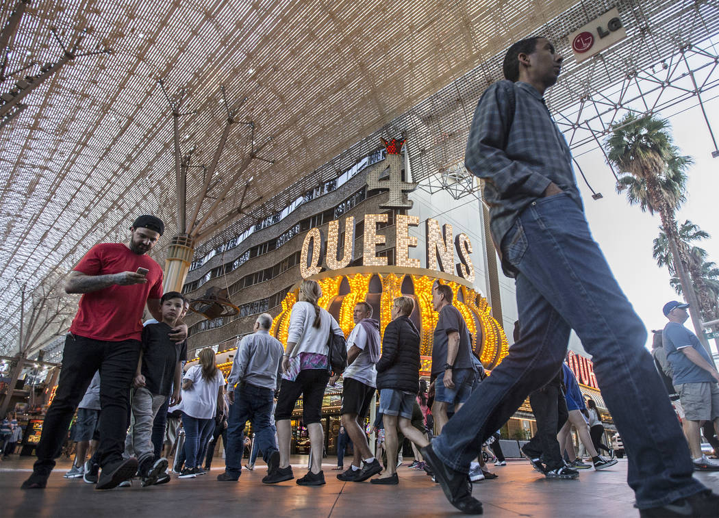 Fremont Street is packed with visitors on Thursday, March 28, 2019, in Las Vegas. (Benjamin Hag ...